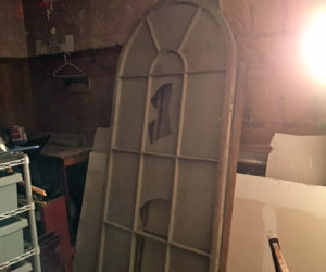 """One of the windows that was found under the Lincoln Theater stage. """"We had to break a hole in the wall to recover it,"""" said Lincoln Theater Executive Director Andrew Fenniman. """"It is being restored and being put back up on the Main Street side of the building."""" (Photo courtesy Lincoln Theater)"""
