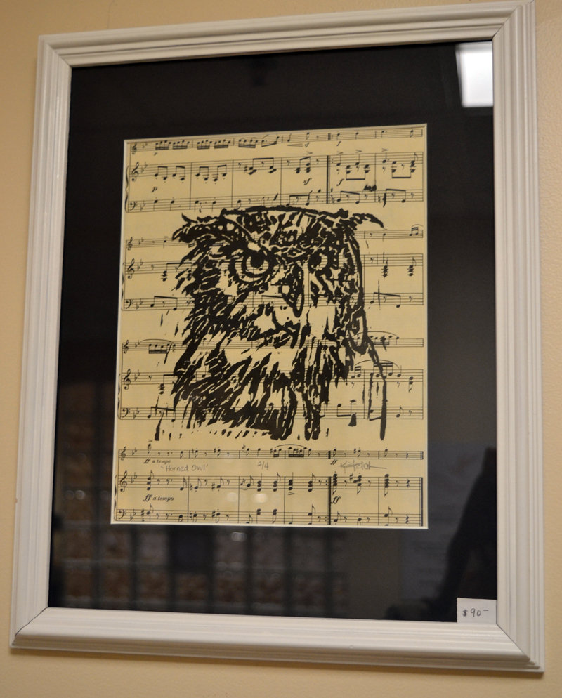 Untitled print of owl's head on recycled sheet music by Union printmaker Kathy Felch. (Christine LaPado-Breglia photo)