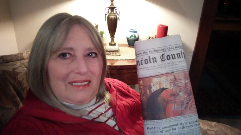 Sandee Brackett holds a copy of the Nov. 30 edition of The Lincoln County News with her photo on the front page. The photo won the November contest before going on to take the annual contest too. (Photo courtesy Sandee Brackett)