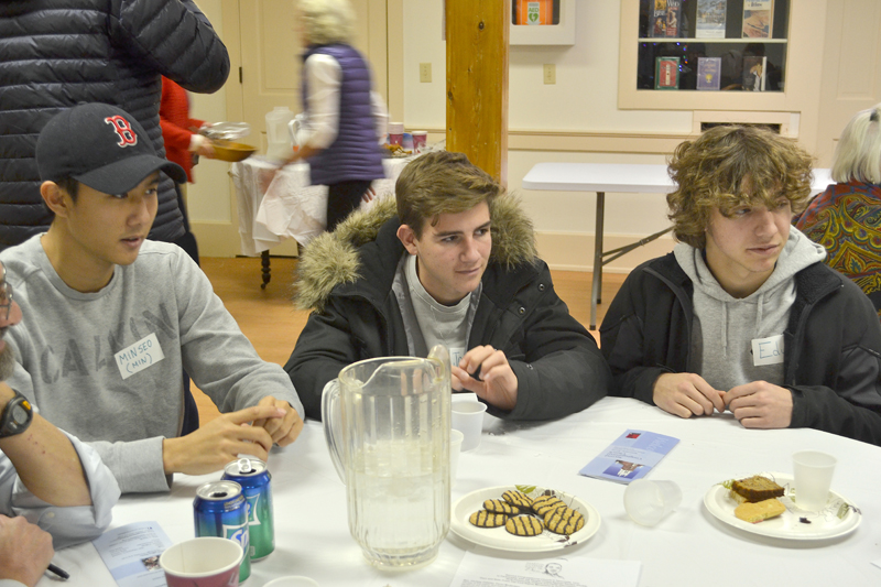 From left: Lincoln Academy students Min Choi, Jorge Pulido Fernandez, and Eduardo Martin-Chico participate in a discussion about racism at The Second Congregational Church in Newcastle on Monday, Jan. 15. (Maia Zewert photo)