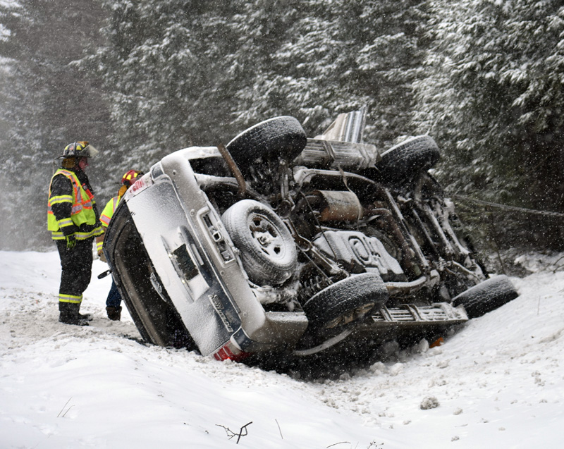 Waldoboro firefighters work at the scene of a rollover on Route 1. Emergency responders extricated two of the vehicle's four occupants. (Alexander Violo photo)