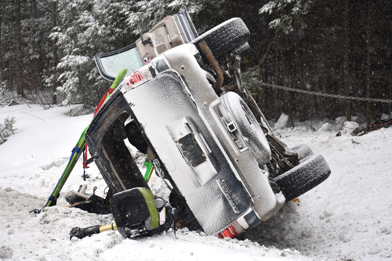 The scene of a rollover on Route 1 in Waldoboro after firefighters and emergency medical services personnel extricated two occupants from the SUV. (Alexander Violo photo)
