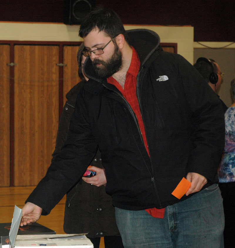 Noah Rosen casts his ballot during a special town meeting at Miller School in Waldoboro on Saturday, Jan. 6. Voters approved a moratorium on recreational-marijuana businesses. (Alexander Violo photo)