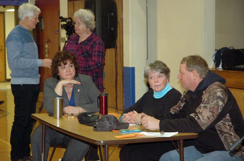 The Waldoboro Board of Selectmen and Town Manager Julie Keizer attend a special town meeting at Miller School on Saturday, Jan. 6. From left (at table): Keizer and Selectmen Jann Minzy and Abden Simmons. Background: Selectmen Bob Butler and Katherine Winchenbach. (Alexander Violo photo)