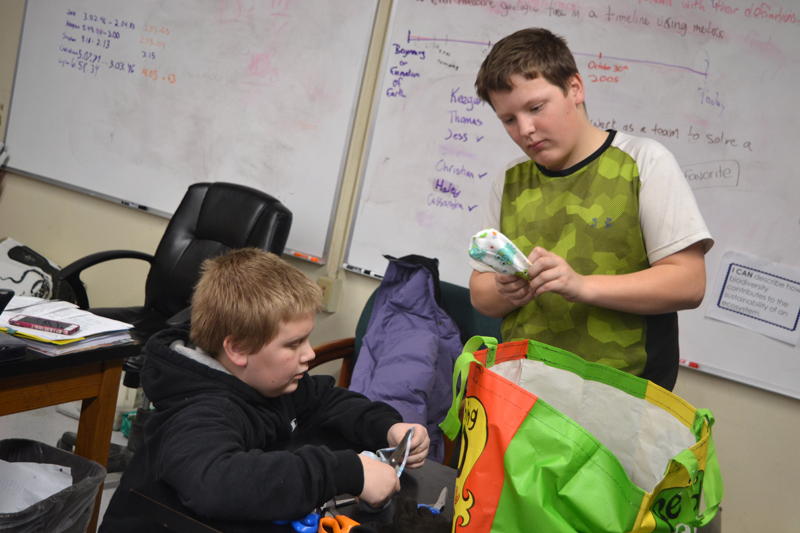 Whitefield Elementary School seventh-graders Bryce Lincoln (left) and Tyler Margitan trim sewn cloth hearts and turn them right-side out during the Whitefield National Junior Honor Society's Preemie Project event after school Friday, Jan. 19. (Christine LaPado-Breglia photo)