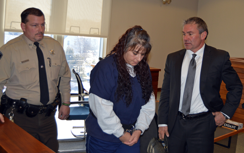Lincoln County Sheriff's Deputy James Read and defense attorney Philip S. Cohen flank Shawna L. Gatto during a court appearance in Rockland on Thursday, Jan. 25. (Greg Foster photo)