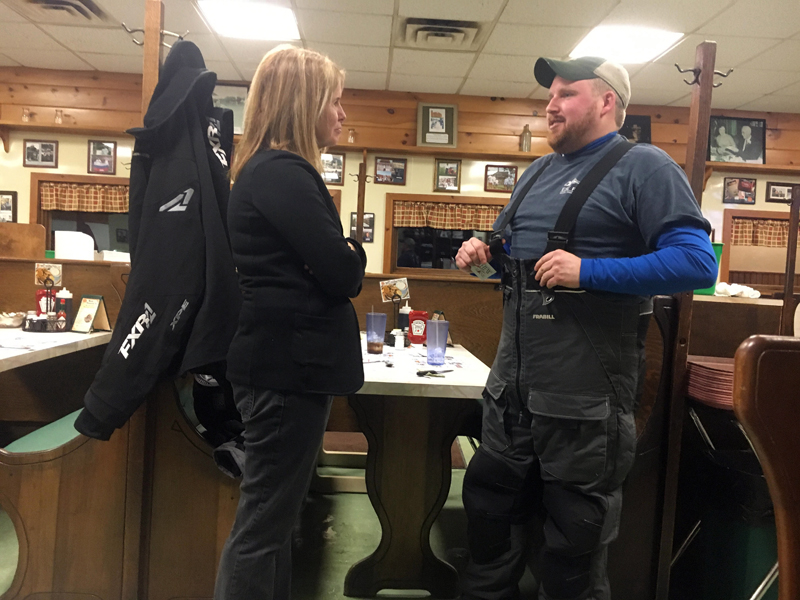 Mary Mayhew speaks with Dustin Delano at Moody's Diner in Waldoboro.