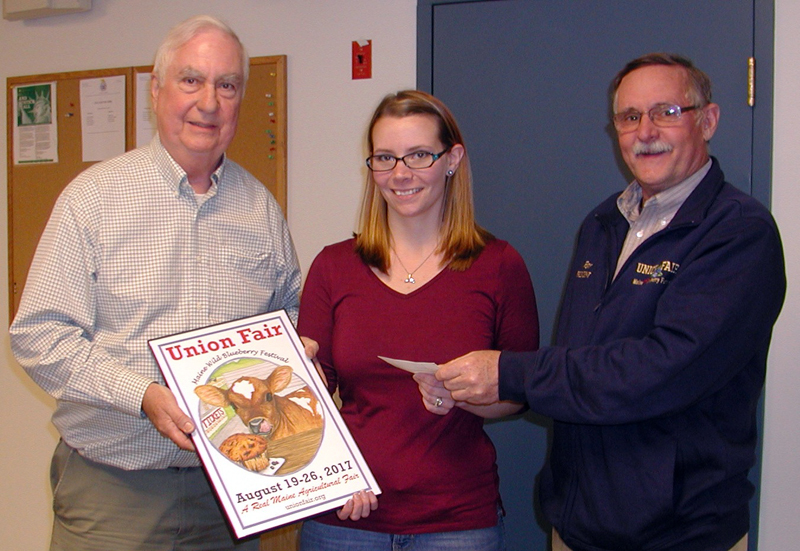 From left: George Gross, Union Fair -- Maine Wild Blueberry Festival poster committee chair, holds the 2017 Union Fair poster while poster winner Alyssa Willey, of Warren, accepts a $500 check from Union Fair -- Maine Wild Blueberry Festival President Ron Hawes for her winning design. (Photo courtesy John Jensen)