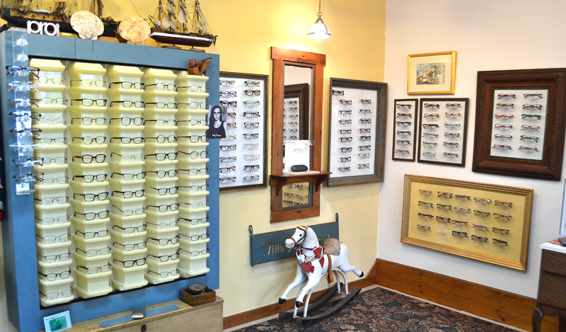 Some of the glasses for sale at Village Optical in Main Street Centre in Damariscotta. Much of the decor was picked out by owner Jane Hall or given to her by clients. (Maia Zewert photo)