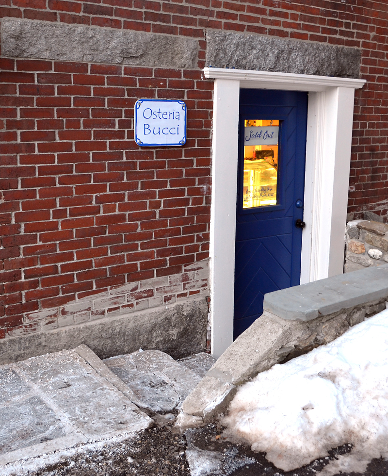 The entrance to Osteria Bucci, on Taco Alley in downtown Damariscotta. (Maia Zewert photo)