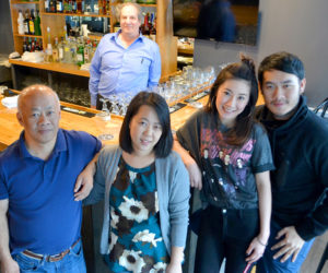 O-Cha owner Pongsakorn Hanjitsuwan (right) celebrates the opening of the Thai-insipred bar and grill with his family and the restaurant's general manager, Jason Simonds (back). From left: Chanint Hanjitsuwan, Simonds, Thanyalak Rojpanichkul, Samatchaya Limvathanalert, and Hanjitsuwan. (Maia Zewert photo)