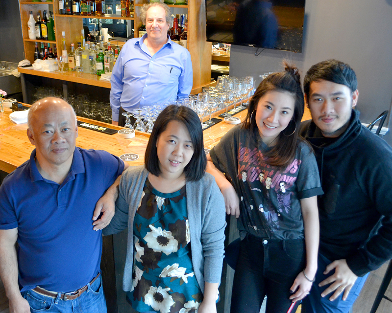 O-Cha owner Pongsakorn Hanjitsuwan (right) celebrates the opening of the Thai-insipred bar and grill with his family and the restaurant's general manager, Jason Simonds (back). From left: Chanint Hanjitsuwan, Simonds, Thanyalak Rojpanichkul,  Samatchaya Limvathanalert, and Hanjitsuwan. (Maia Zewert photo)