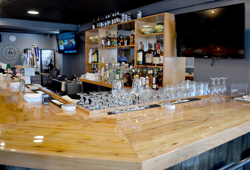 The handcrafted bar built by Bruce Plourde and Pete Colby at O-Cha, a Thai-inspired bar and grill at 88 Main St. in Damariscotta. (Maia Zewert photo)