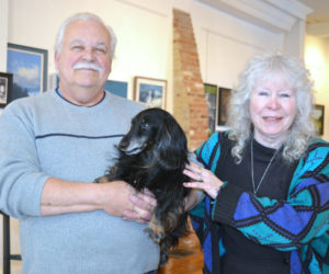 Wolfgang Busse and Polly McGrory pose with Max the gallery dog at McGrory & Wolf Gallery in downtown Waldoboro on Thursday, Feb. 1. (Christine LaPado-Breglia photo)