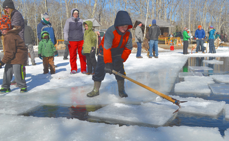 Lincoln Ball uses an antique hand tool to guide a block of ice during the ice harvest at the Thompson Ice House in South Bristol on March 12, 2017. The 2018 event is scheduled for Sunday, Feb. 18. (Maia Zewert photo)