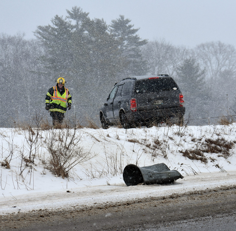 A Waldoboro firefighter at the scene of a rollover on Route 220 the morning of Sunday, Feb. 4. (Alexander Violo photo)