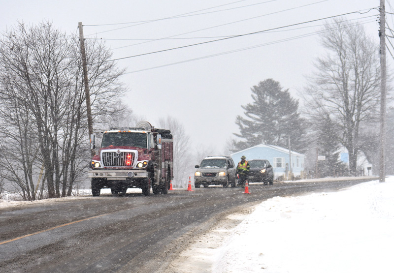 Traffic was stopped while crews removed a vehicle from the side of Route 220 in Waldoboro on Sunday, Feb. 4. There were no injuries in the single-vehicle rollover. (Alexander Violo photo)