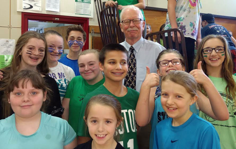 "Whitefield Elementary School interim Principal Tom Soule poses for a photo with students. ""I think we have great days ahead of us,"" Soule said. (Greg Foster photo)"