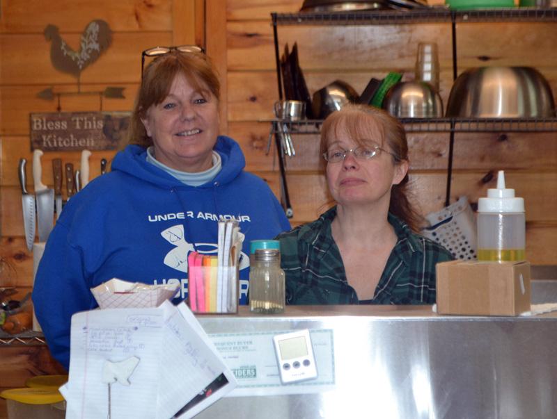 Carla Chapman (left) and Lettie Mott will open the Cubbyhole Sports Pub on West Alna Road in Wiscasset on March 2. (Charlotte Boynton photo)