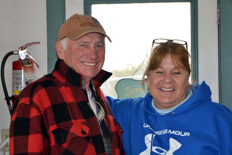 Wiscasset General Store owner Carla Chapman greets customer Merle West. The store will reopen as the Cubbyhole Sports Pub on March 2. (Charlotte Boynton photo)