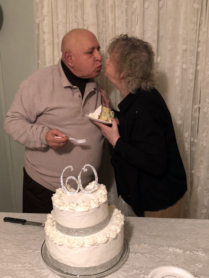 Richard and Mary Onorato steal a kiss during their surprise 60th anniversary celebration Jan. 27. Daughter-in-law Kathy Onorato made the cake, as she did for their 25th and 40th anniversaries. (Photo courtesy Onorato family)