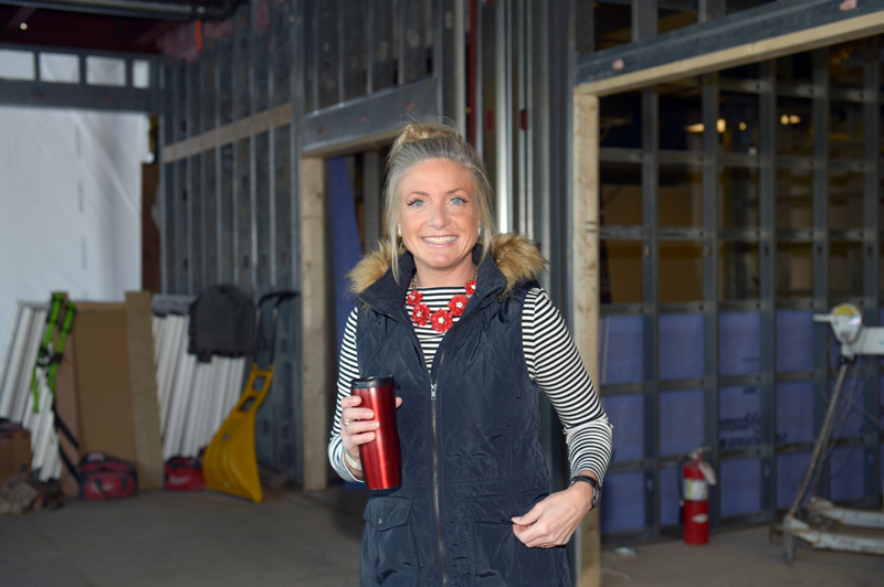 CLC YMCA CEO Meagan Hamblett stands in what will become a community gathering spot, complete with high and low seating and free Wi-Fi. (Paula Roberts photo)