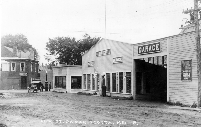 Motors Service Station, where H.M. Castner was proprietor and was agent for Chandler & Cleveland Cars in the 1920s. Note the tall gas pump in front of Hall's Garage. These buildings sat in front of the Motors of Maine Inc. garage on Elm Street in the 1920s. (Photo courtesy Marjorie and Calvin Dodge)