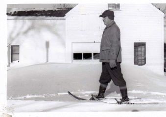 John Glidden heads for his office, 1952, on snowshoes. (Photo courtesy Newcastle Historical Society)