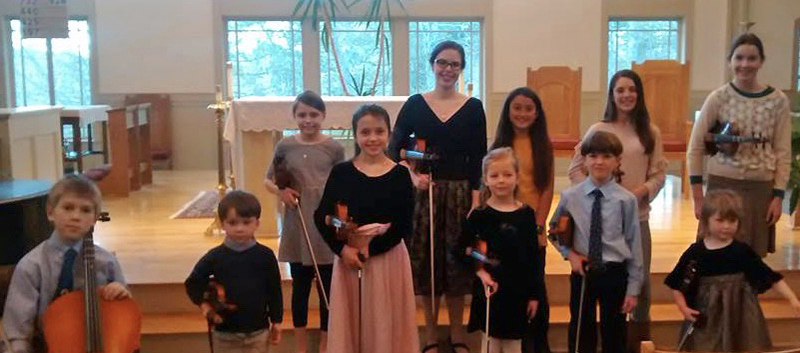 The young violin and cello players who performed on Jan. 28 at St. Patrick's Catholic Church in Newcastle.