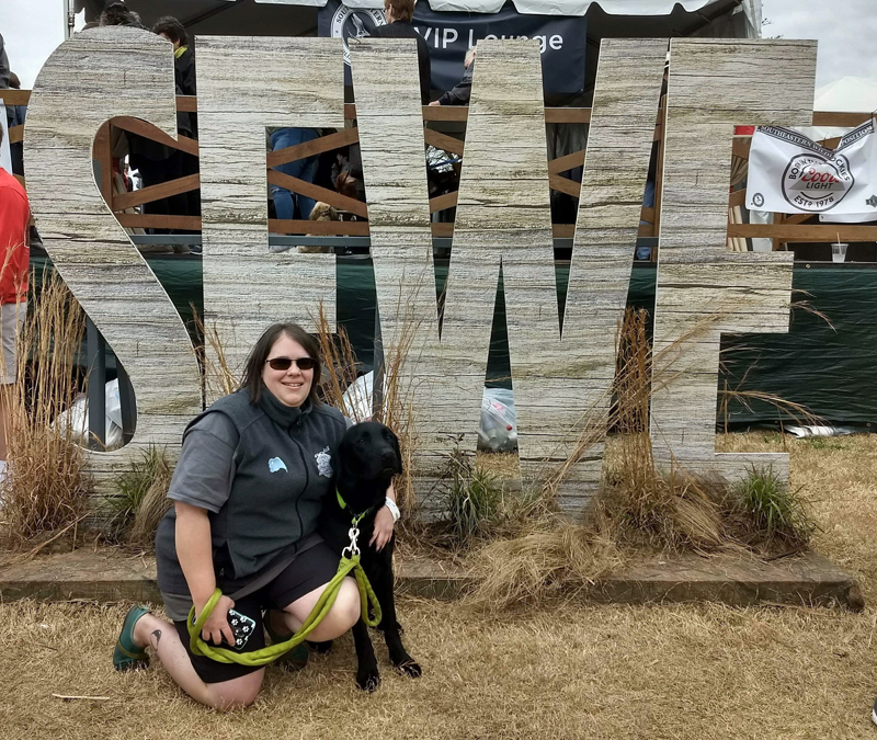 Erin Bailey and Casco pose at the Southeastern Wildlife Exposition in Charleston, South Carolina. (Photo courtesy Jessica Bailey)