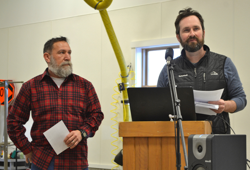 Alna General Store co-owner Ken Solorzano (left) looks on as Jon Villeneuve explains their petition proposing changes to the town's liquor rules during a public hearing Monday, March 12. (Maia Zewert photo)