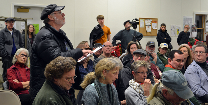 Alna resident Ray Robitaille asks a question about Ed Pentaleri's presentation during a public hearing about the upcoming school choice referendum at the Alna fire station Monday, March 5. (Maia Zewert photo)