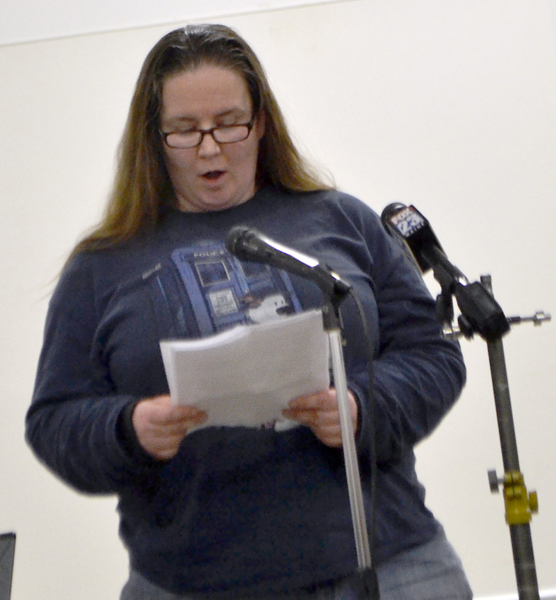 Alna resident Ona Brazwell reads a statement in favor of keeping the town's school choice policy the same during a public hearing Monday, March 5. (Maia Zewert photo)