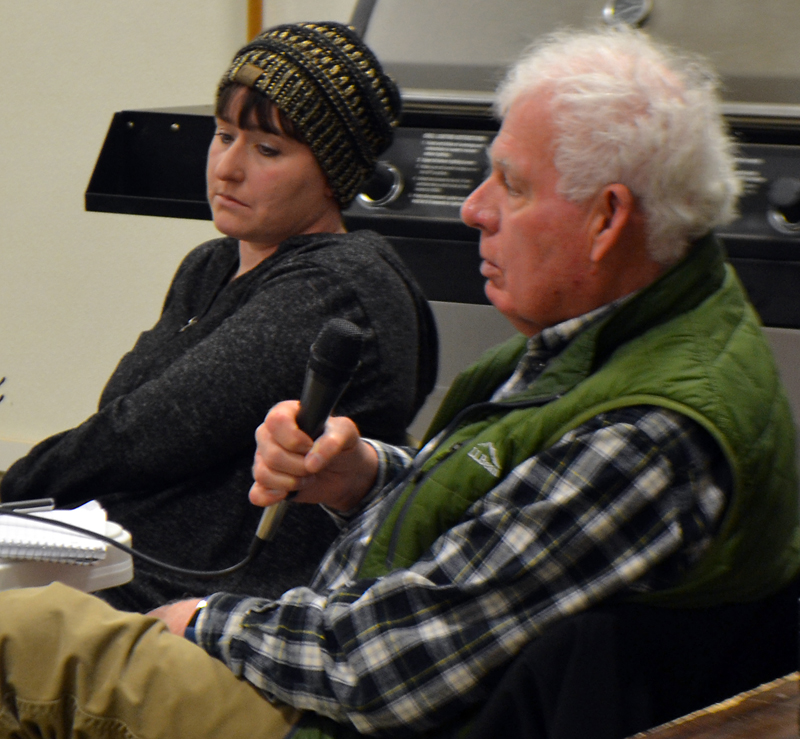 Alna Third Selectman Doug Baston responds to a question while Second Selectman Melissa Spinney looks on during a public hearing regarding school choice Monday, March 5. (Maia Zewert photo)