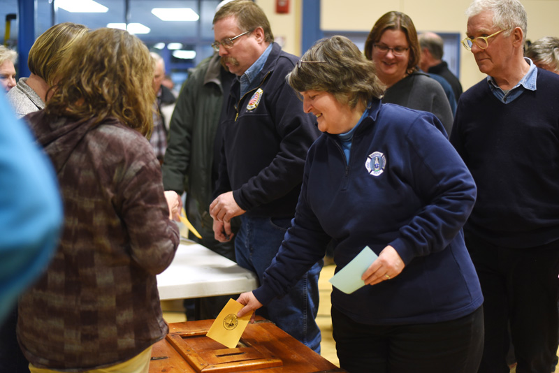 Bristol residents submit a secret ballot on whether they approve hiring a full-time fire chief during the Bristol town meeting Tuesday, March 21. (Jessica Picard photo)