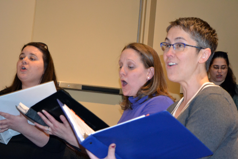 """From left: Emily Mirabile, Kristen Robinson, and Victoria Hamilton, who play Judy Bernley, Doralee Rhodes, and Violet Newstead, respectively, in the Lincoln County Community Theater production of """"9 to 5: The Musical,"""" sing at a rehearsal Sunday, March 25. Chorus member Barbara Belknap is in the background at right. (Christine LaPado-Breglia photo)"""