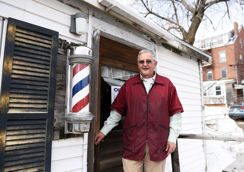 Bruce Soule stands in front of his barbershop in downtown Damariscotta Thursday, March 15. Soule has been cutting hair there for 36 years. (Jessica Picard photo)