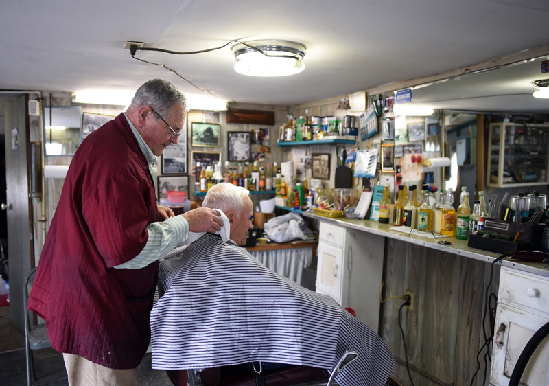 Bruce Soule cuts George Sawtelle's hair at his barbershop in downtown Damariscotta on Thursday, March 15. (Jessica Picard photo)
