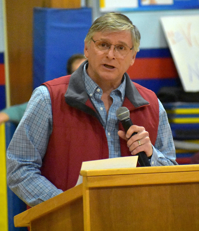 Lincoln County Democratic Committee Chair Chris Johnson welcomes voters to a caucus at Great Salt Bay Community School in Damariscotta on Sunday, March 4. (Alexander Violo photo)