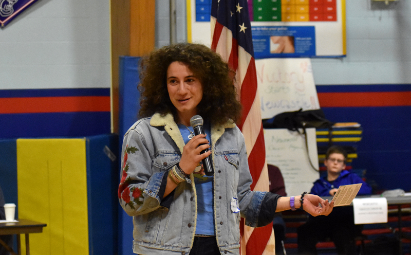 Maine House District 88 candidate Chloe Maxmin, D-Nobleboro, talks to voters at the Democratic caucus in Damariscotta. (Alexander Violo photo)