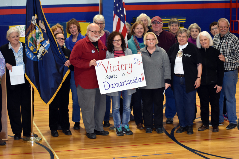 Damariscotta Democrats pose for a photo at the start of the town caucus at Great Salt Bay Community School on Sunday, March 4. (Alexander Violo photo)