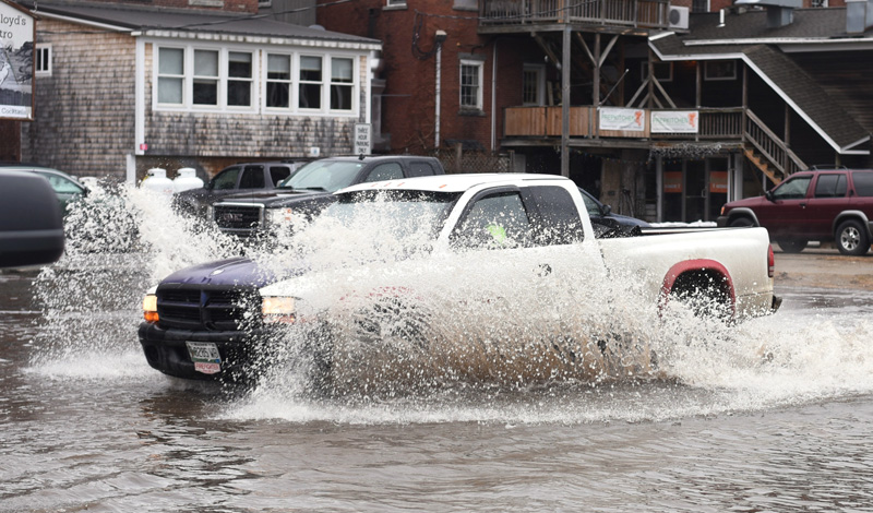 A truck drives through floodwaters in the municipal parking lot in downtown Damariscotta on Friday, March 2. (Jessica Picard photo)