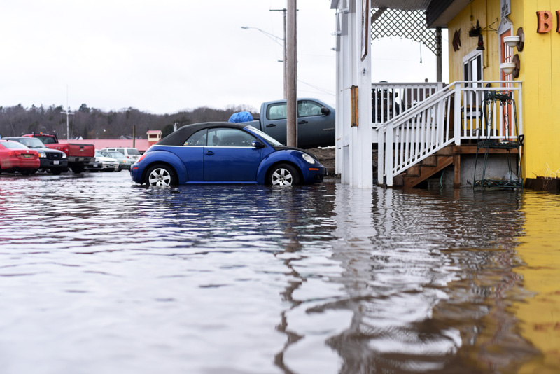 The water reaches the steps of Van Lloyd's Bistro in the municipal parking lot of downtown Damariscotta on Friday, March 2. (Jessica Picard photo)