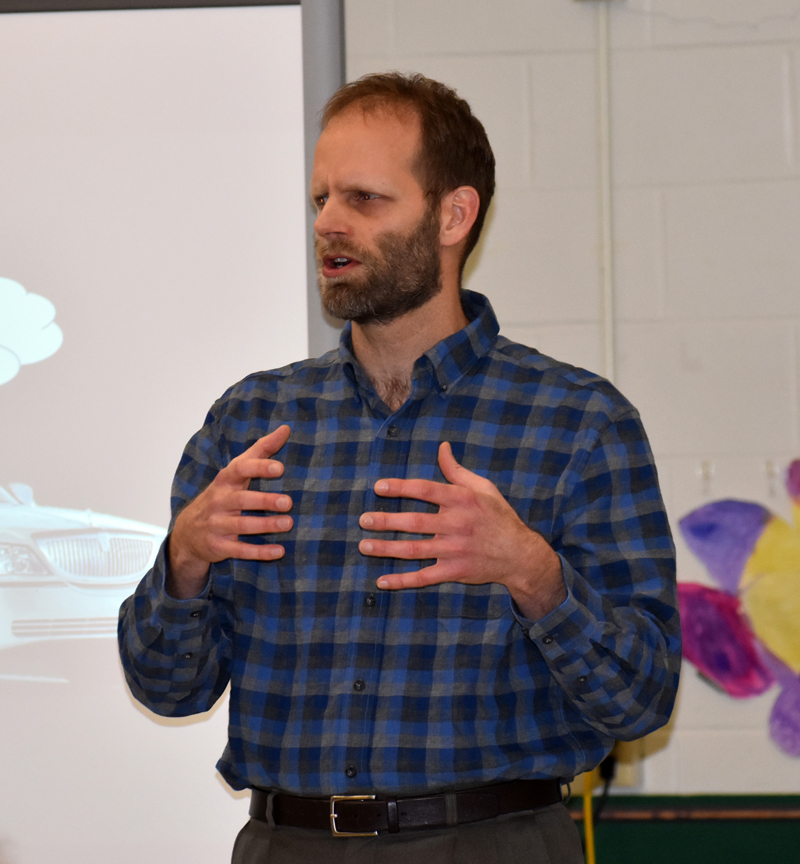 Garret Martin, of Newcastle, presents the results of AOS 93's survey about Lincoln Academy during a meeting at Great Salt Bay Community School in Damariscotta on Thursday, March 15. (Alexander Violo photo)