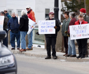 Participants in the nationwide March for Our Lives protest line the Damariscotta-Newcastle bridge Saturday, March 24. (Jessica Picard photo)