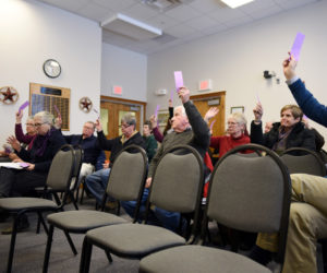 Damariscotta residents vote to approve the purchase of the barbershop site for new public restrooms during a special town meeting at the town office Wednesday, March 21. (Jessica Picard photo)