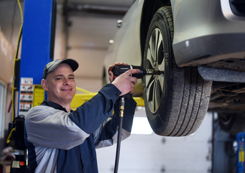 The Garage owner Scott Dupuis works on a car at his business in Damariscotta on Tuesday, Feb. 27. (Jessica Picard photo)
