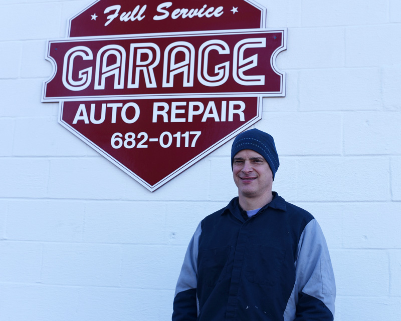 The Garage owner Scott Dupuis stands in front of his business in Damariscotta on Tuesday, Feb. 27. (Jessica Picard photo)