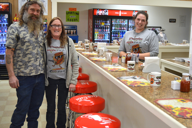 From left: Dresden Take Out owners Mason and Kathy Dubord show off the store's new breakfast and lunch counter as Catherine Lilly stands ready to serve customers. (Greg Foster photo)