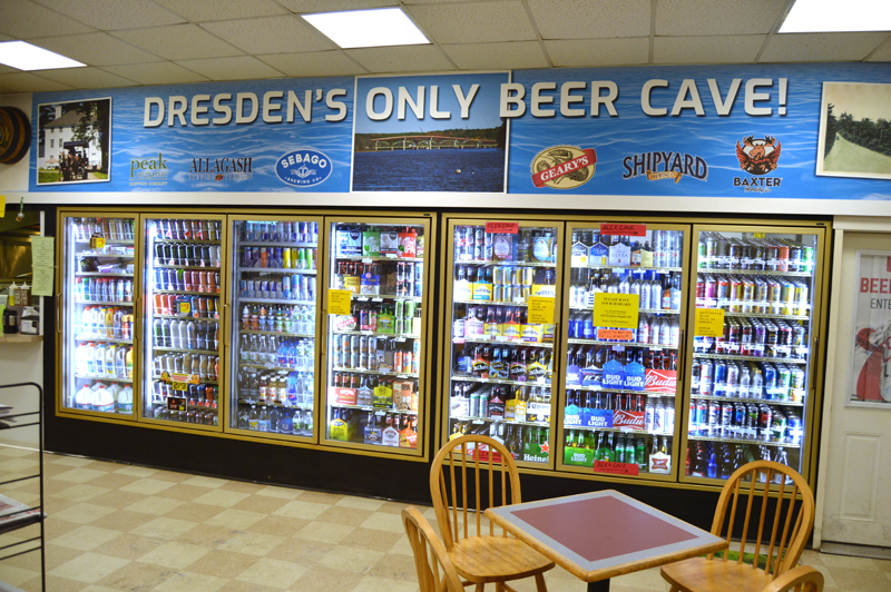 "A sign at the Dresden Take Out boasts of ""Dresden's only beer cave!"" (Greg Foster photo)"